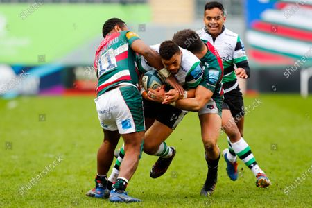 Luther Burrell of Newcastle Falcons is stopped by Kini Murimurivalu and Dan Kelly of Leicester Tigers; Mattoli Woods Welford Road Stadium, Leicester, Midlands, England; Premiership Rugby, Leicester Tigers versus Newcastle Falcons.