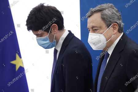Italian Prime Minister Mario Draghi and Health Minister Roberto Speranza leave after a presser in Rome