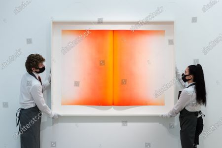 Staff members present Anish Kapoor's (b. 1954) Fold VI etching in colours, 2016, estimate: £20,000-30,000 during preparations for 'Prints & Multiples' online sale at Christie's auction house, on March 26, 2021 in London, England.