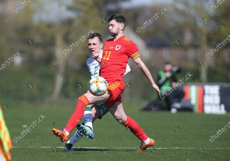 Ireland's Lee O'Connor and Wales' Joe Adams tussle for the ball