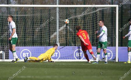 Joe Adams (hidden to left) scores first goal of match and celebrates