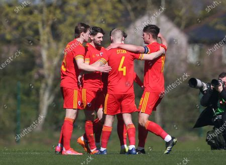 Joe Adams celebrates scoring the first goal of the match with his team