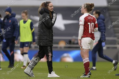 Stock Image of (L-R) Lisa Evans and Kim Little of Arsenal Women after the WomenÕs Super League match between Tottenham Hotspur Women and Arsenal Women at The Tottenham Hotspur Stadium in London - 28th March 2021