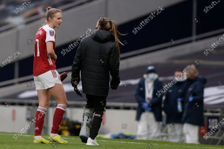 Stock Photo of (L-R) Vivianne Miedema and Lisa Evans  of Arsenal Women after the WomenÕs Super League match between Tottenham Hotspur Women and Arsenal Women at The Tottenham Hotspur Stadium in London - 28th March 2021