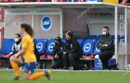 Brighton's Manager Hope Powell takes the knee along with the two teamsduring the FA Women's Super League match between Brighton and Hove Albion and Everton at the People's Pension Stadium in Crawley.