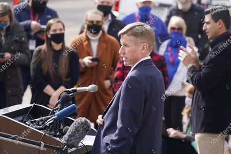 Boulder County, Colo., District Attorney Michael Dougherty makes a point to outline the ongoing investigation into the mass shooting at a King Soopers grocery store during a news conference outside police headquarters, in Boulder, Colo