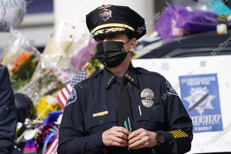 Boulder, Colo., Police Department Chief Maris Herold listens as Boulder County, Colo., District Attorney Michael Dougherty makes a point to outline the ongoing investigation into the mass shooting at a King Soopers grocery store during a news conference outside police headquarters, in Boulder, Colo