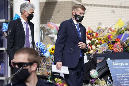Boulder County, Colo., District Attorney Michael Dougherty heads to a news conference to outline the ongoing investigation into the mass shooting at a King Soopers grocery store outside police headquarters, in Boulder, Colo