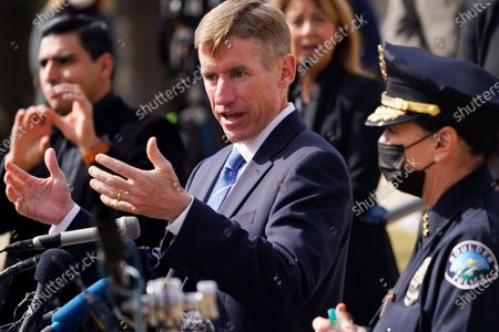 Boulder, Colo., Police Department Chief Maris Herold, front, listens as Boulder County, Colo., District Attorney Michael Dougherty makes a point to outline the ongoing investigation into the mass shooting at a King Soopers grocery store during a news conference outside police headquarters, in Boulder, Colo. Ten people were killed in the shooting at the supermarket on Monday