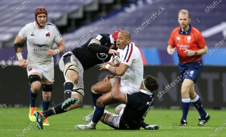 France vs Scotland. Scotland's Grant Gilchrist and Sam Skinner tackle Gael Fickou of France