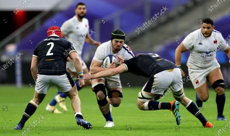 France vs Scotland. Scotland's George Turner and Grant Gilchrist tackle Gregory Alldritt of France