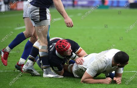 France vs Scotland. France's Swan Rebbadj scores his side's third try despite Grant Gilchrist of Scotland