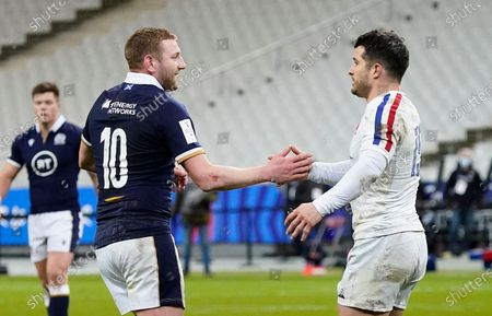 France vs Scotland. Scotland's Finn Russell and Brice Dulin of France embrace after Russell was sent off for a leading arm on Dulin