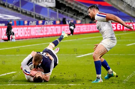 France vs Scotland. Scotland's Finn Russell is tackled by Brice Dulin of France with Russell later being sent off for the challenge