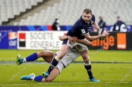France vs Scotland. France's Virimi Vakatawa tackles Finn Russell of Scotland