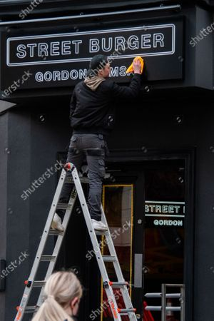 Stock Image of Adding the finishing touches as Gordon Ramsay's Street Burger takes over the Byron on Charing Cross Road, London UK. 26 March 2021 Photo by robin pope / Nurphoto