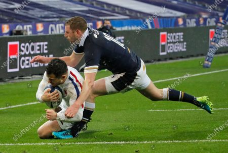 France's Brice Dulin scores the opening try despite the tackle of Scotland's Finn Russell during the Six Nations rugby union international match between France and Scotland at the Stade de France in Saint-Denis, near Paris