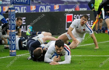 France's Brice Dulin scores the opening try for his team despite the tackle of Scotland's Finn Russell during the Six Nations rugby union international match between France and Scotland at the Stade de France in Saint-Denis, near Paris