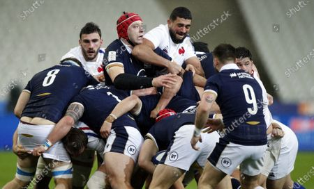 Swan Rebbadji (C-R) of France in action against Grant Gilchrist (C-L) of Scotland during the Rugby Six Nations match between France and Scotland in Saint-Denis, outside Paris, France, 26 March 2021.