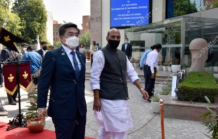 Defence Minister Rajnath Singh with South Korean Defence Minister Suh Wook (L) prior to a meeting and Tri-service Guard of Honour at Sushma Swaraj Bhawan (Pravasi Bharatiya Kendra),  on March 26, 2021 in New Delhi, India.