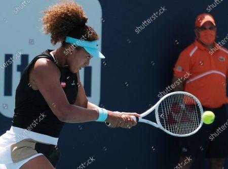 Naomi Osaka from Japan returns the ball to Ajla Tomljanovic from Australia