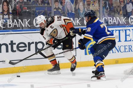 St. Louis Blues' Justin Faulk (72) defends against Anaheim Ducks' Ryan Getzlaf (15) during the third period of an NHL hockey game, in St. Louis