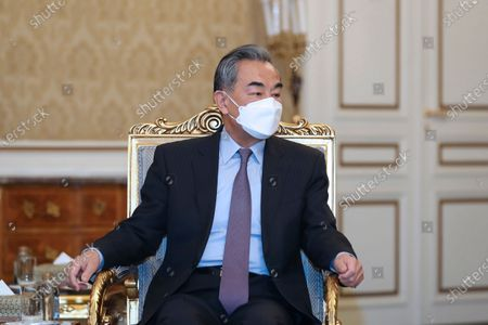 In this photo released by the official website of the office of the Iranian Presidency, Chinese Foreign Minister Wang Yi listens to President Hassan Rouhani during their meeting, in Tehran, Iran