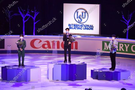 (L-R) Silver medalist Yuma Kagiyama of Japan, gold medalist Nathan Chen of USA and bronze medalist Shoma Uno of Japan celebrate on the podium after the Men's free skating at the ISU World Figure Skating Championships at the Globe Arena in Stockholm, Sweden, 27 March 2021.