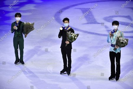 (L-R) Silver medalist Yuma Kagiyama of Japan, gold medalist Nathan Chen of USA and bronze medalist Shoma Uno of Japan pose with their medals after the Men's free skating at the ISU World Figure Skating Championships at the Globe Arena in Stockholm, Sweden, 27 March 2021.
