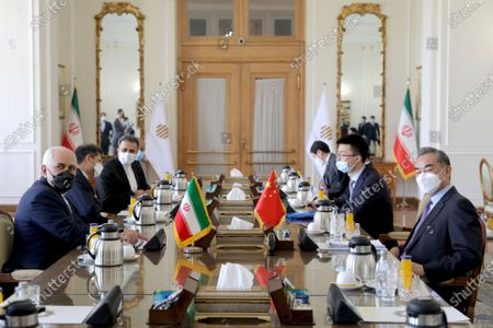 Iranian Foreign Minister Mohammad Javad Zarif, left, and his Chinese counterpart Wang Yi, right, attend a meeting, in Tehran, Iran, . Iran and China on Saturday signed a 25-year strategic cooperation agreement addressing economic issues amid crippling U.S. sanctions on Iran, state TV reported