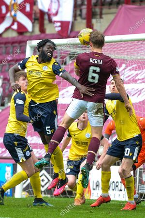 Stock Photo of Christophe Berra (#6) of Heart of Midlothian FC beats Ayo Obileye (#5) of Queen of the South FC to a header during the SPFL Championship match between Heart of Midlothian and Queen of the South at Tynecastle Park, Edinburgh