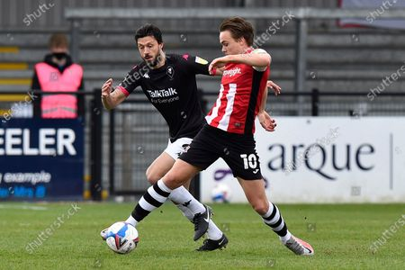 Archie Collins (10) of Exeter City battles for possession with Jason Lowe (4) of Salford City during the EFL Sky Bet League 2 match between Exeter City and Salford City at St James' Park, Exeter