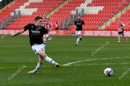 Ashley Hunter (10) of Salford City shoots at goal during the EFL Sky Bet League 2 match between Exeter City and Salford City at St James' Park, Exeter