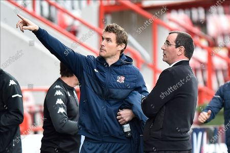 Exeter City manager Matt Taylor talks to Salford City manager Gary Bowyer before kickoff during the EFL Sky Bet League 2 match between Exeter City and Salford City at St James' Park, Exeter