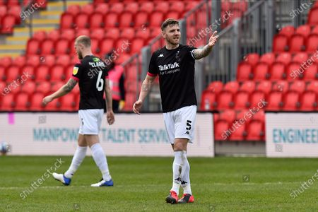 Ashley Eastham (5) of Salford City gestures during the EFL Sky Bet League 2 match between Exeter City and Salford City at St James' Park, Exeter