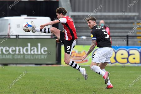Ben Seymour (9) of Exeter City on the attack chased by Ashley Eastham (5) of Salford City during the EFL Sky Bet League 2 match between Exeter City and Salford City at St James' Park, Exeter