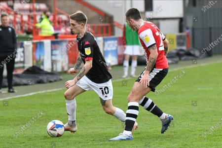 Ashley Hunter (10) of Salford City battles for possession with Lewis Page (20) of Exeter City during the EFL Sky Bet League 2 match between Exeter City and Salford City at St James' Park, Exeter