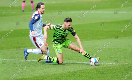 Taylor Allen of Forest Green Rovers is fouled by Michael Jordan Williams of Bolton Wanderers