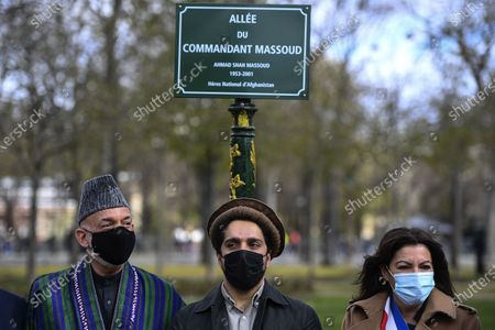 (L-R) Former Afghan President Hamid Karzai, Ahmad Massoud, son of late Afghan commander Ahmad Shah Massoud and Paris Mayor Anne Hidalgo pose after unveiling a commemorative plaque in honour of late Afghan anti-Taliban commander Massoud in an alley along the Champs-Elysees Avenue in Paris, France, 27 March 2021.