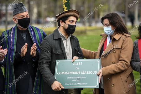 Ahmad Massoud (C), son of late Afghan commander Ahmad Shah Massoud, holds a spare plaque flanked by former Afghan President Hamid Karzai (L) and Paris mayor Anne Hidalgo (R) after unveiling a commemorative plaque in honour of late Afghan anti-Taliban commander Massoud in an alley along the Champs-Elysees Avenue in Paris, France, 27 March 2021.