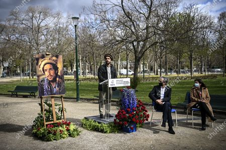 Ahmad Massoud, son of late Afghan commander Ahmad Shah Massoud, flanked by Paris Mayor Anne Hidalgo (R) and French author Bernard-Henri Levy (2-R) delivers a speech during a ceremony to unveil a commemorative plaque in honour of late Afghan anti-Taliban commander Massoud in an alley along the Champs-Elysees Avenue in Paris, France, 27 March 2021.