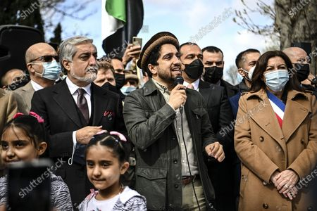 Ahmad Massoud (C), son of late Afghan commander Ahmad Shah Massoud, flanked by Paris Mayor Anne Hidalgo (R) and Chairman of Afghanistan's High Council for National Reconciliation Abdullah Abdullah (L), addresses supporters on the sidelines of a ceremony to unveil a commemorative plaque in honour of late Afghan anti-Taliban commander Massoud in an alley along the Champs-Elysees Avenue in Paris, France, 27 March 2021.