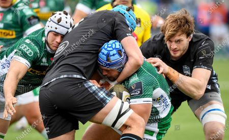 Glasgow Warriors vs Benetton Rugby. Benetton's Gianmarco Lucchesi is tackled by James Scott of Glasgow Warriors