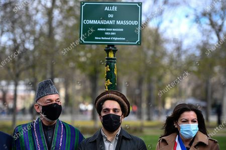 From left to right, former Afghan President Hamid Karzai, Ahmad Massoud, son of late Afghan commander Ahmad Shah Massoud and Paris Mayor Anne Hidalgo pose after unveiling a commemorative plaque in honor of late Afghan anti-Taliban commander Massoud in an alley along the Champs Elysees Avenue in Paris
