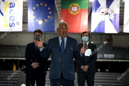 Stock Image of Portuguese Prime Minister Antonio Costa speaks to journalists on the first day of the teaching and non-teaching staff inoculation against COVID-19 at the Odivelas Multipurpose Pavilion in Lisbon, Portugal, on March 27, 2021. Portugal started massive inoculation against COVID-19 for all teaching and non-teaching staff on Saturday, with around 280,000 people scheduled to be immunized over the next weeks, while the government plans to slowly ease restrictions on coronavirus and reopen all teaching levels.