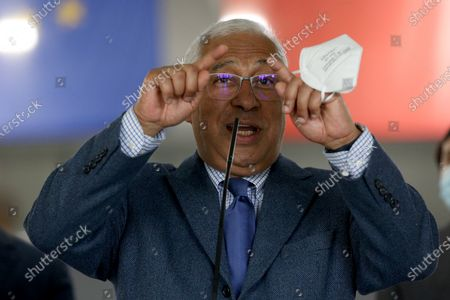 Stock Photo of Portuguese Prime Minister Antonio Costa speaks to journalists on the first day of the teaching and non-teaching staff inoculation against COVID-19 at the Odivelas Multipurpose Pavilion in Lisbon, Portugal, on March 27, 2021. Portugal started massive inoculation against COVID-19 for all teaching and non-teaching staff on Saturday, with around 280,000 people scheduled to be immunized over the next weeks, while the government plans to slowly ease restrictions on coronavirus and reopen all teaching levels.