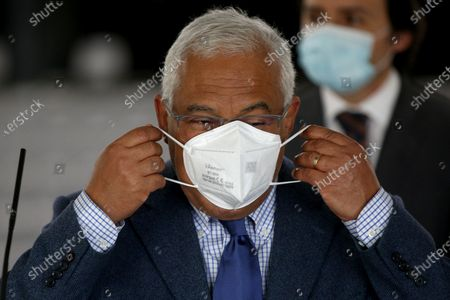 Portuguese Prime Minister Antonio Costa puts on his face mask after speaking to journalists on the first day of the teaching and non-teaching staff inoculation against COVID-19 at the Odivelas Multipurpose Pavilion in Lisbon, Portugal, on March 27, 2021. Portugal started massive inoculation against COVID-19 for all teaching and non-teaching staff on Saturday, with around 280,000 people scheduled to be immunized over the next weeks, while the government plans to slowly ease restrictions on coronavirus and reopen all teaching levels.