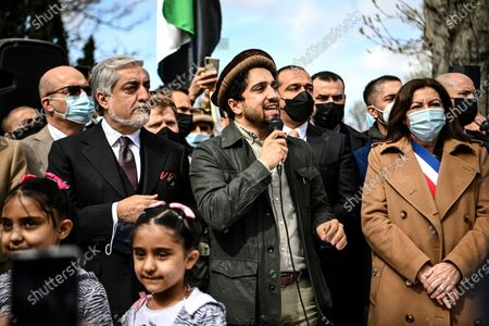Ahmad Massoud, son of late Afghan commander Ahmad Shah Massoud, center, speaks supporters as he is flanked by Chairman of Afghanistan's High Council for National Reconciliation Abdullah Abdullah, left, and Paris Mayor Anne Hidalgo on the sidelines of a commemoration to honor late Afghan anti-Taliban commander Massoud in an alley along the Champs Elysees Avenue in Paris
