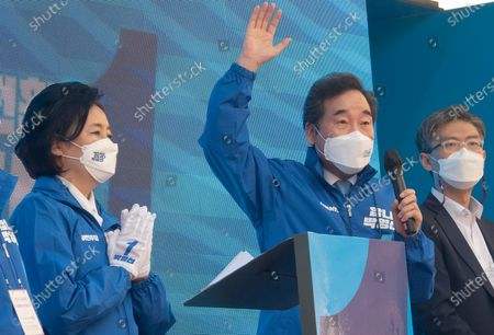 Lee Nak-Yon (2nd R), a former Democratic Party (DP) chief who is currently co-chairing the party's election committee for the upcoming April 7 by-elections, speaks as the ruling DP's Seoul mayoral candidate Park Young-Sun (L) participates in a campaign rally.  The mayoral by-election in Seoul will be held on April 7, 2021.