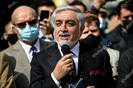 Chairman of Afghanistan's High Council for National Reconciliation Abdullah Abdullah speaks to supporters on the sidelines of a commemoration to honor late Afghan anti-Taliban commander Massoud in an alley along the Champs Elysees Avenue in Paris
